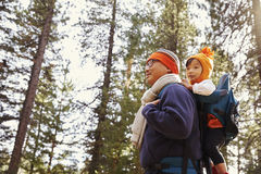 Father with toddler daughter on walk in forest close up Stock Photos