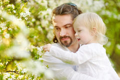 Father and toddler girl having fun at spring Royalty Free Stock Photo