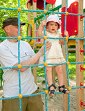Father with toddler  on playing field Royalty Free Stock Images