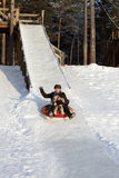 Father with toddler ride on a sled Stock Photo