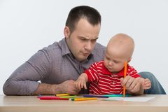 Father and toddler son drawing Stock Images
