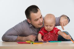 Father and toddler son drawing Royalty Free Stock Images