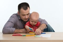 Father and toddler son drawing Stock Photo