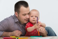 Father and toddler son drawing Royalty Free Stock Photography