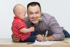 Father and toddler son drawing Stock Photography