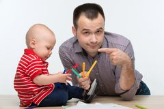 Father and toddler son drawing Stock Photos
