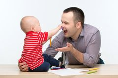Father and toddler son drawing Stock Image