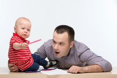 Father and toddler son drawing Royalty Free Stock Image