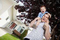 Father with Toddler Son on Shoulders Stock Images