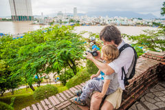Father and Toddler Son tourists in Ventname. Po Nagar Cham Tovers. Asia Travel concept. Journey through Vietnam Concept royalty free stock photography