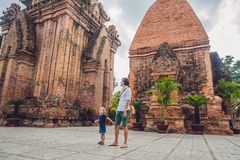 Father and Toddler Son tourists in Vietnam. Po Nagar Cham Tovers. Asia Travel concept. Journey through Vietnam Concept royalty free stock image
