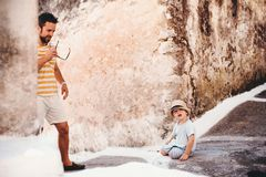 A father with toddler son in town on summer holiday. royalty free stock photography