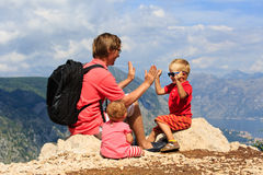 Father with tow kids having fun in mountains Stock Photo