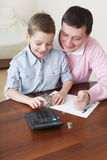 Father training the son to the finance Royalty Free Stock Images