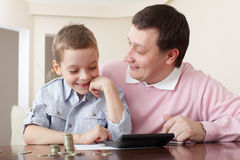 Father training the son to the finance Stock Photography