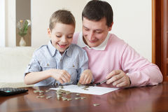 Father training the son to the finance royalty free stock photography