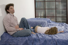 Father try to discipline daughter. Naughty girl, father attempting to discipline his daughter royalty free stock photos