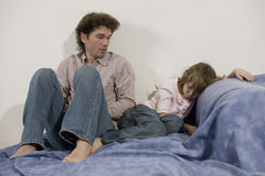 Father try to discipline daughter. Naughty girl, father attempting to discipline his daughter stock images