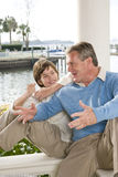 Father and tween son talking. Father talking to son on waterfront terrace Stock Photography