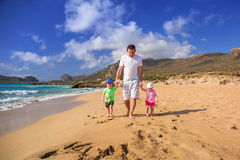 Father with twins on the beach holidays Royalty Free Stock Photos