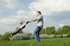 Free Father Twirling His Little Son Stock Image - 10809251