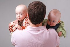 Father with two baby Royalty Free Stock Photos