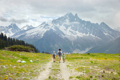 Father and two boys hike in mountain Stock Photos