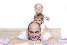 Father and two children at home Stock Photography