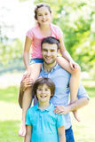 Father with two children Stock Photos