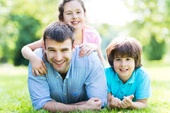 Father with two children Stock Photography
