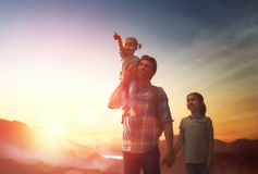 Father and two children at sunset Royalty Free Stock Photos
