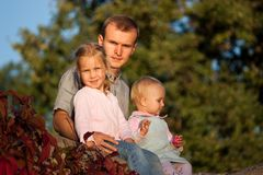 Father with two daughters Royalty Free Stock Images