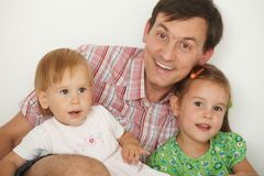 Father with two daughters having fun Royalty Free Stock Photography