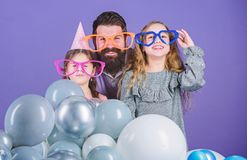 Father with two daughters having fun. Fatherhood concept. Friendly family wear funny party accessories. Best dad ever. Fathers day. Daughters need father stock photography