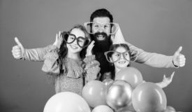 Father with two daughters having fun. Fatherhood concept. Friendly family wear funny party accessories. Fathers day. Daughters need father actively interested royalty free stock photo