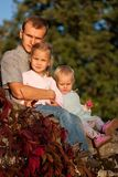 Father with two daughters in summer Royalty Free Stock Images