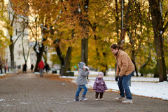 Father and two kids having fun on winter day Stock Image