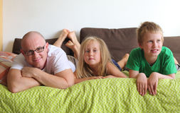 Father with two kids. At home Stock Photos