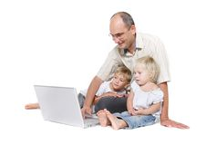 Father and two kids with laptop Stock Image