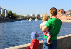 Father with two kids looking at summer city Royalty Free Stock Photo