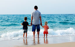 Father with two kids o Royalty Free Stock Photo