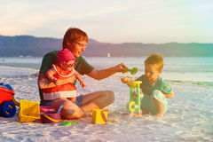 Father with two kids playing on tropical beach Royalty Free Stock Images