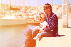 Father and two kids in port of Malta Stock Photos