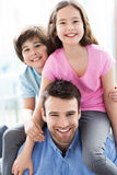 Father with two kids Stock Photos