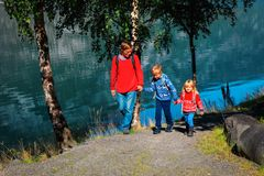 Father with kids walking travel in nature. Father with two kids- son and daughter- walking travel in nature, family travel stock image