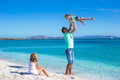 Father and two kids during their tropical vacation Royalty Free Stock Images