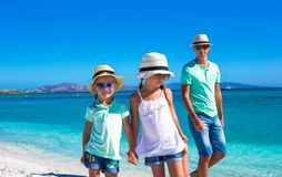 Father and two kids during their tropical vacation Stock Photo