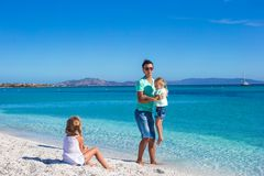 Father and two kids during their tropical vacation Royalty Free Stock Photo