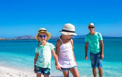 Father and two kids during their tropical vacation Stock Photos