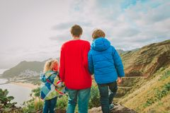 Father and two kids travel hiking looking at nature. Family travel royalty free stock image